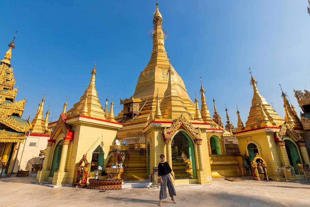 Woman with Golden Pagoda Yangon Myanmar